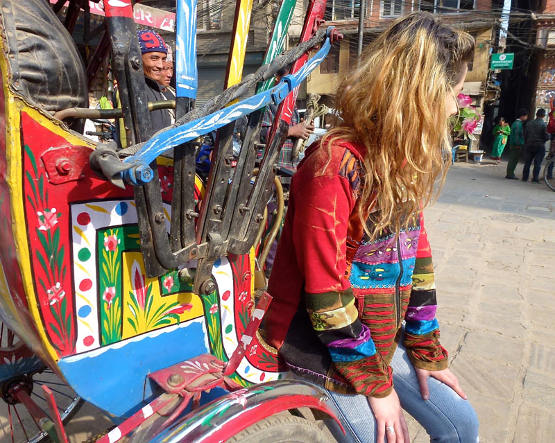 Wearing a hippie clothing in the form of a funky hoodie, sitting on a cyclo in Kathmandu, Nepal.