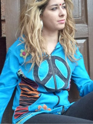 Turquoise peace sign hoodie, with razor cut on the sides and flower patches. The black peace sign is on the chest.